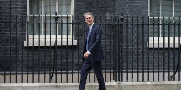 British Foreign Secretary Philip Hammond walks to 10 Downing Street in central London on July 13, 2016...