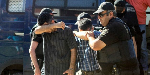 Turkish military personnel who were aboard a Blackhawk military helicopter are transferred to a prosecutor's...