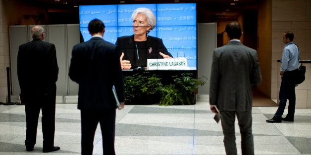 International Monetary Fund Managing Director Christine Lagarde is seen on a screen speaking during a...