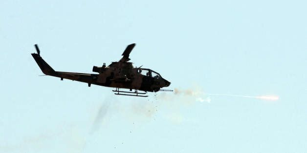 A combat Cobra helicopter fires during an Efes-2009 Military Exercise in Izmir on May 26, 2009. Turkish...