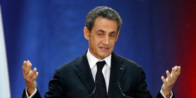 FILE- In this Thursday, Sept. 25, 2014 file photo, former French President, Nicolas Sarkozy, speaks as...