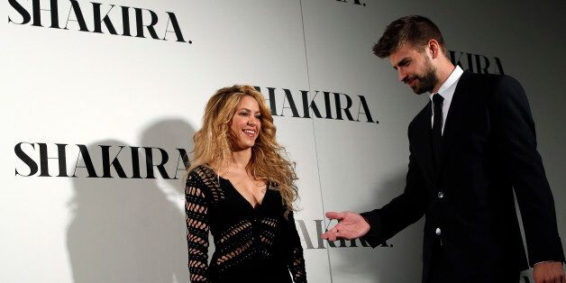 Colombian singer Shakira and Barcelona's soccer player Gerard Pique (R) pose during a photocall presenting her new album