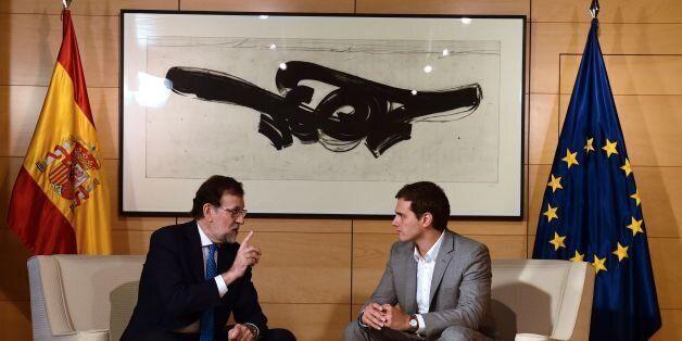 Spanish interim Prime Minister, Mariano Rajoy (L) speaks with center-right party Ciudadanos leader, Albert...