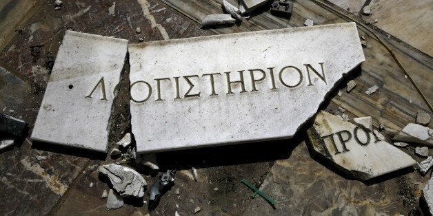 A broken marble sign that