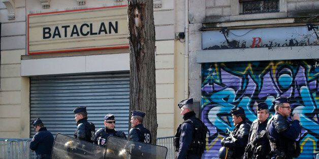 Riot police officers guard the Bataclan concert hall in Paris, Thursday, March 17, 2016. French lawmakers...