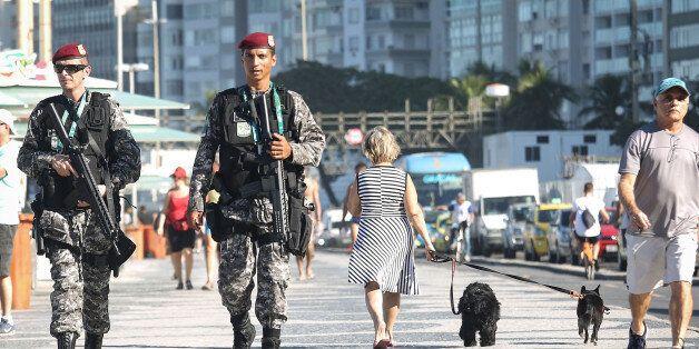 RIO DE JANEIRO, BRAZIL - JULY 05: Brazilian National Force soldiers patrol along Copacabana beach, a...