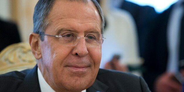 Russian Foreign Minister Sergey Lavrov smiles as he speaks to Jordanian Foreign Minister Nasser Judeh...