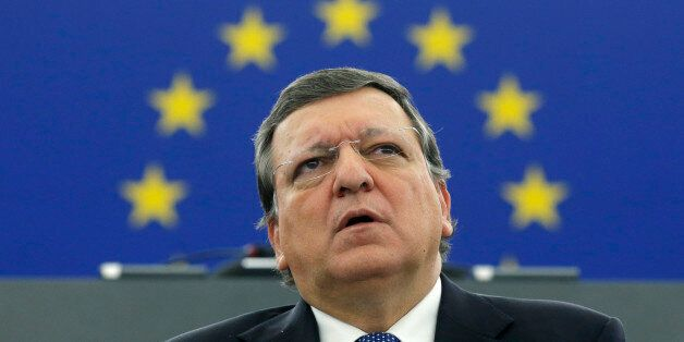 Outgoing European Commission President Jose Manuel Barroso delivers his speech as he attends the review...