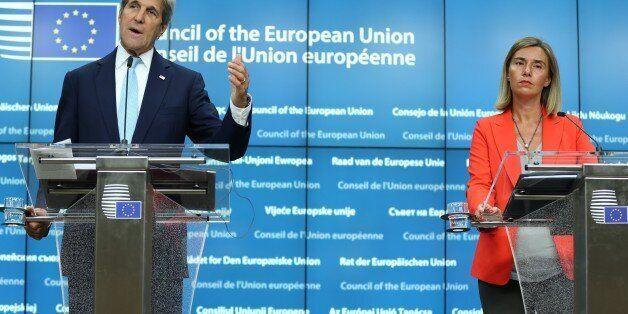 BRUSSELS, BELGIUM - JULY 18: US Secretary of State John Kerry (L) and High Representative of the European...