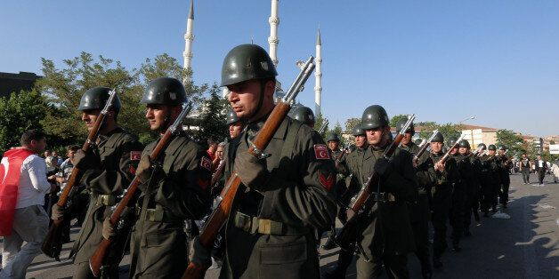 Turkish soldiers march after a mass funeral for the victims of a failed military coup last Friday, outside...