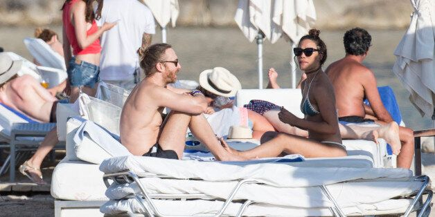 IBIZA, SPAIN - JULY 06: David Guetta and girlfriend enjoy a day at a beach club on July 6, 2016 in Ibiza,...