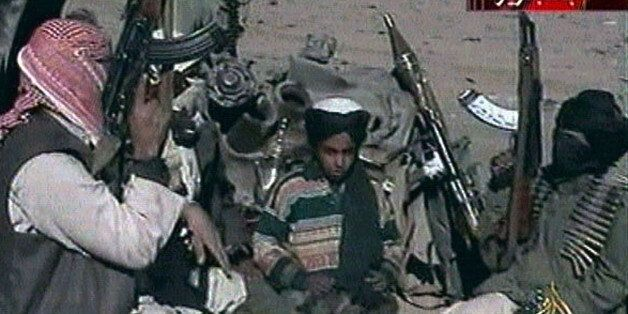 Picture taken from Al Jazeera television purportedly shows Hamza bin Osama bin Laden (C), one of the...