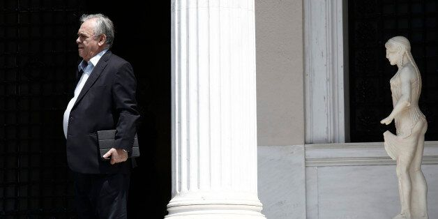 Yannis Dragasakis, Greece's deputy prime minister, leaves Maximos Mansion following a meeting with Alexis...