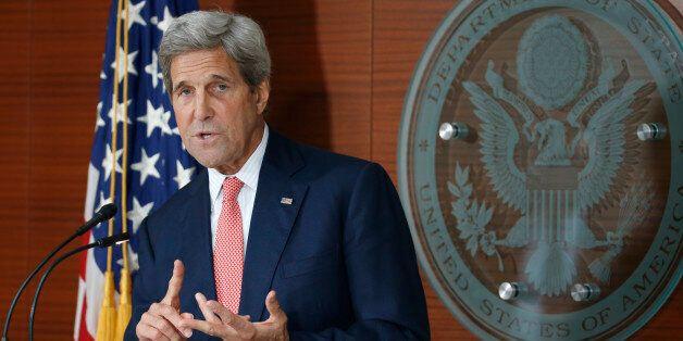 Secretary of State John Kerry speaks at the Washington Passport Agency, Tuesday, July 12, 2016 in Washington....