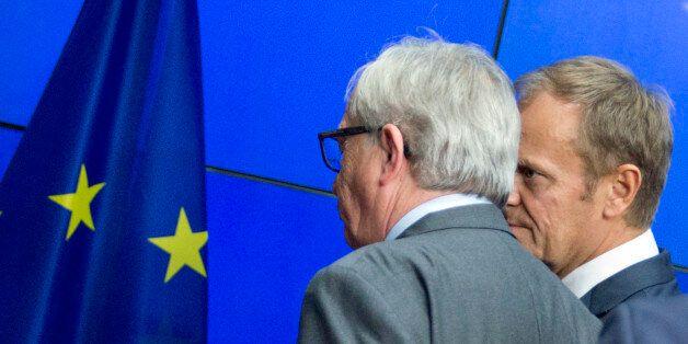 European Commission President Jean-Claude Juncker, left, and European Council President Donald Tusk leave...