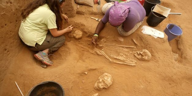 A team of foreign archaeologists extract skeletons at the excavation site of the first Philistine cemetery...