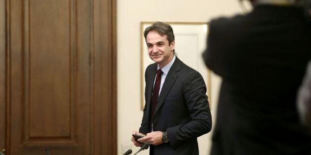 Kyriakos Mitsotakis, president of the Greek liberal-conservative New Democracy party, arrives to attend...