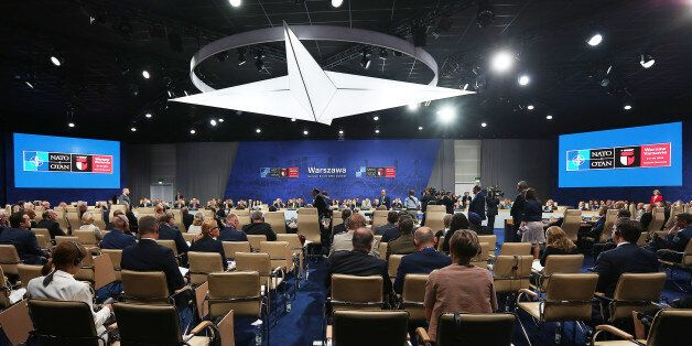 State leaders attend a working session at the NATO summit in Warsaw, Poland, Saturday, July 9, 2016....