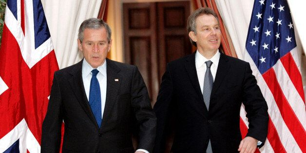 U.S. President George W. Bush (L) and British Prime Minister Tony Blair walk together from their meeting...