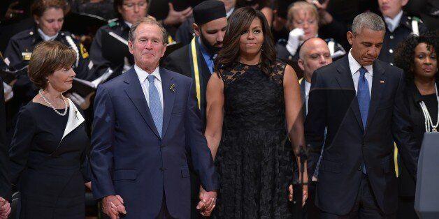 TOPSHOT - L-R: Former first lady Laura Bush, former US president George W. Bush, US First Lady Michelle...