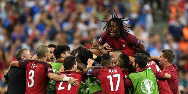 PARIS, FRANCE - JULY 10: Renato Sanches (top) and Portugal players celebrate their team's first goal...