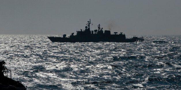 Turkish NATO warship TCG Turgutreis maneuvers on the Black Sea after leaving the port of Constanta, Romania,...