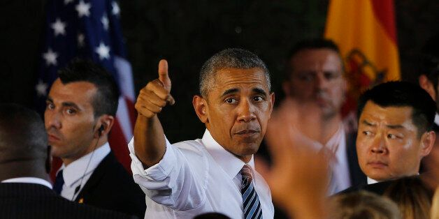 U.S President Barack Obama gives a thumbs up after his speech at the Rota naval airbase, near Cadiz,...