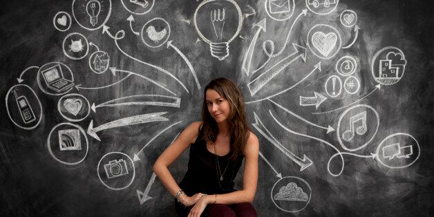 Girl in front of chalkboard with social media icon