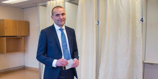 Presidential candidate Gudni Johannesson casts his ballot at a polling station in Reykjavik, on June...