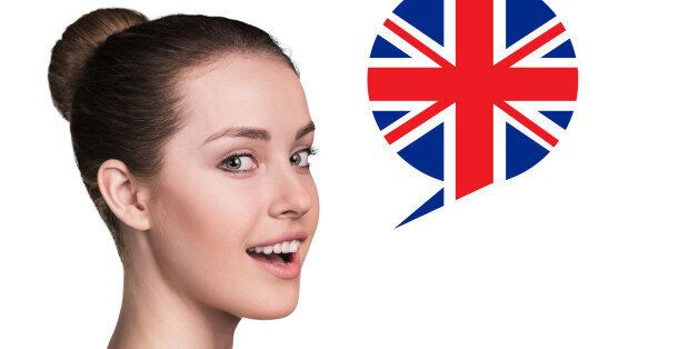 Beautiful woman speak.Bubble with Britain flag. Isolated