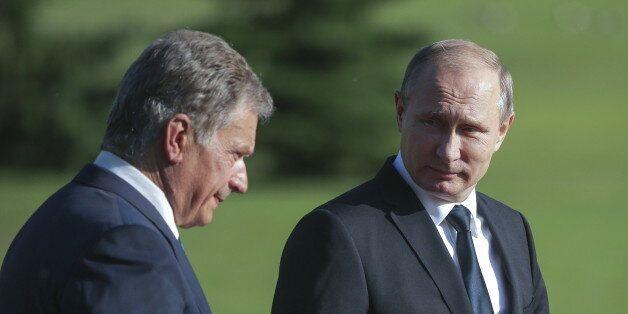 NAANTALI, FINLAND - JULY 1, 2016: Finland's president Sauli Niinisto (L) and Russia's president Vladimir...