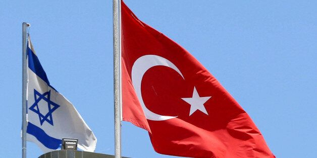 A Turkish flag flutters atop the Turkish embassy as an Israeli flag is seen nearby, in Tel Aviv, Israel...
