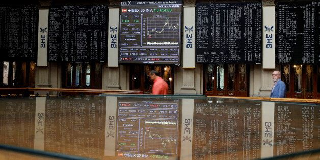 Electronic boards are seen at the Madrid stock exchange which plummeted after Britain voted to leave...