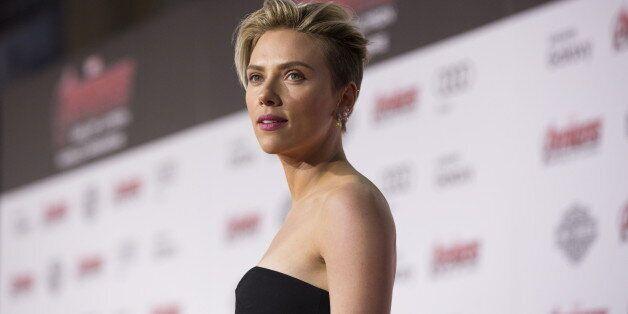 Cast member Scarlett Johansson poses at the premiere