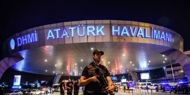 A Turkish riot police officer patrols Ataturk airport`s main enterance in Istanbul, on June 28, 2016,...