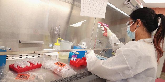 MADISON, WI - JUNE 28: Mariel Mohns, a research specialist at the AIDS Vaccine Research Labs at the University...