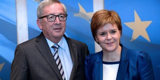 European Union Commission President Jean-Claude Juncker (L) poses with Scotland's First Minister and...