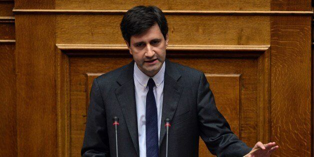Greek Deputy Finance Minister Giorgos Chouliarakis addresses lawmakers during a parliament session prior...