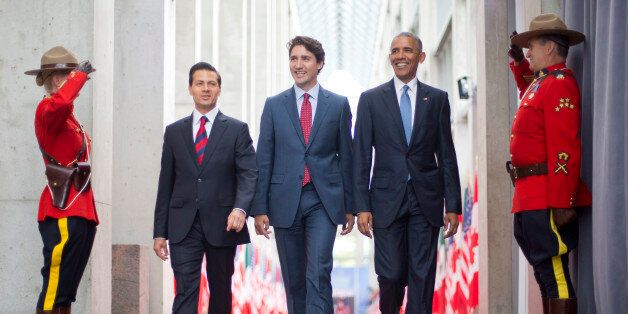 President Barack Obama walks with Canadian Prime Minister Justin Trudeau and Mexican President Enrique...