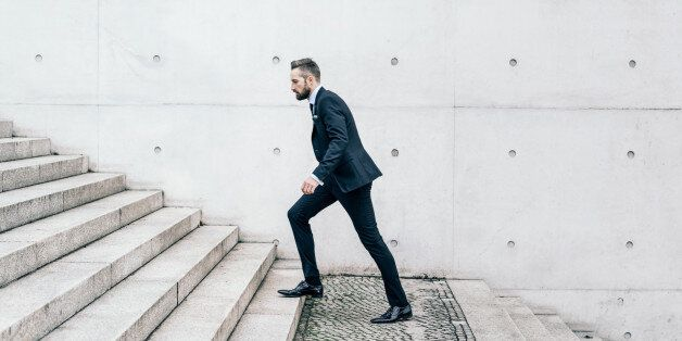 Young businessman walking on stairs in the