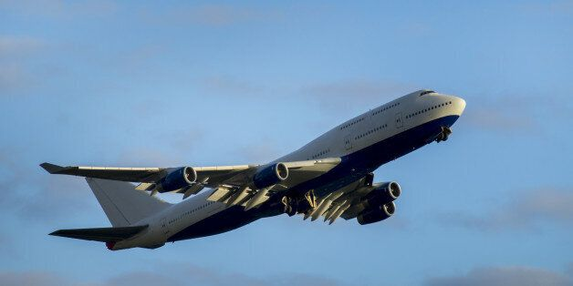 Giant airplane takes off from Heathrow Airport and undercarriage retracts under