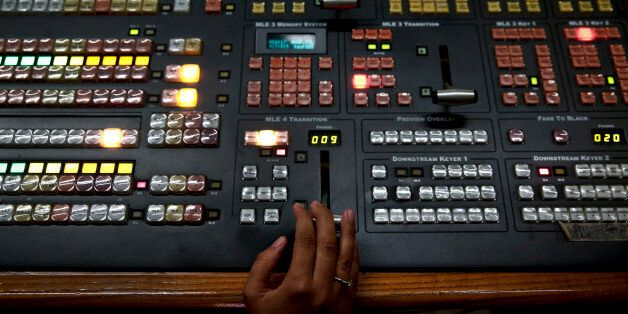 An employee operates a mixing console at the control room of state broadcaster ERT headquarters in Athens...