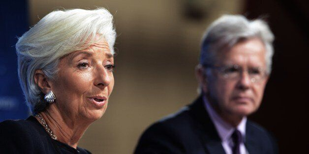 Christrine Lagarde (L) Managing Director of the IMF takes part in a briefing, accompanied by Gerry Rice...