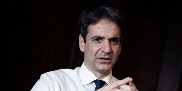 Greek Administrative Reform Minister Kyriakos Mitsotakis speaks during an interview with the Associated...