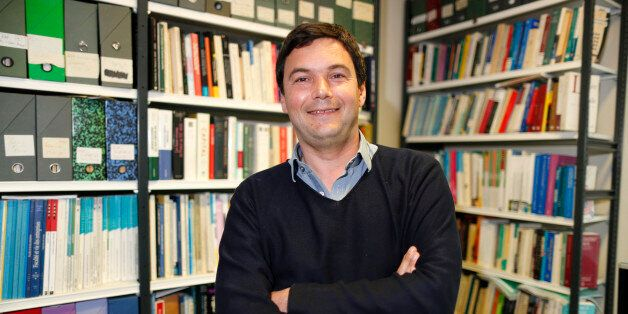 French economist and academic Thomas Piketty, poses in his book-lined office at the French School for...