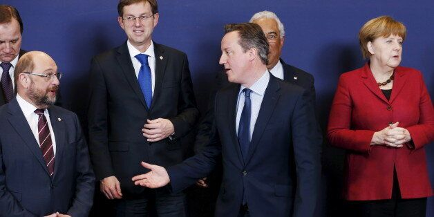 Britain's Prime Minister David Cameron talks to European Parliament President Martin Schulz (L) next...