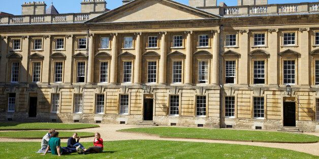 Students sitting outside in spring sunshine, Peckwater Quadrangle, designed by Henry Aldrich, Christ...