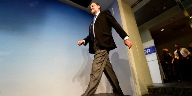 Leader of the Popular Party (PP) and Spain's caretaker Prime Minister, Mariano Rajoy arrives for a press...