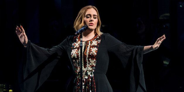 GLASTONBURY, ENGLAND - JUNE 25: Adele performs on The Pyramid Stage on day 2 of the Glastonbury Festival...