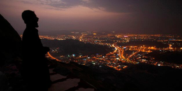 A Muslim pilgrim prays atop Mount Thor in the holy city of Mecca ahead of the annual haj pilgrimage October...